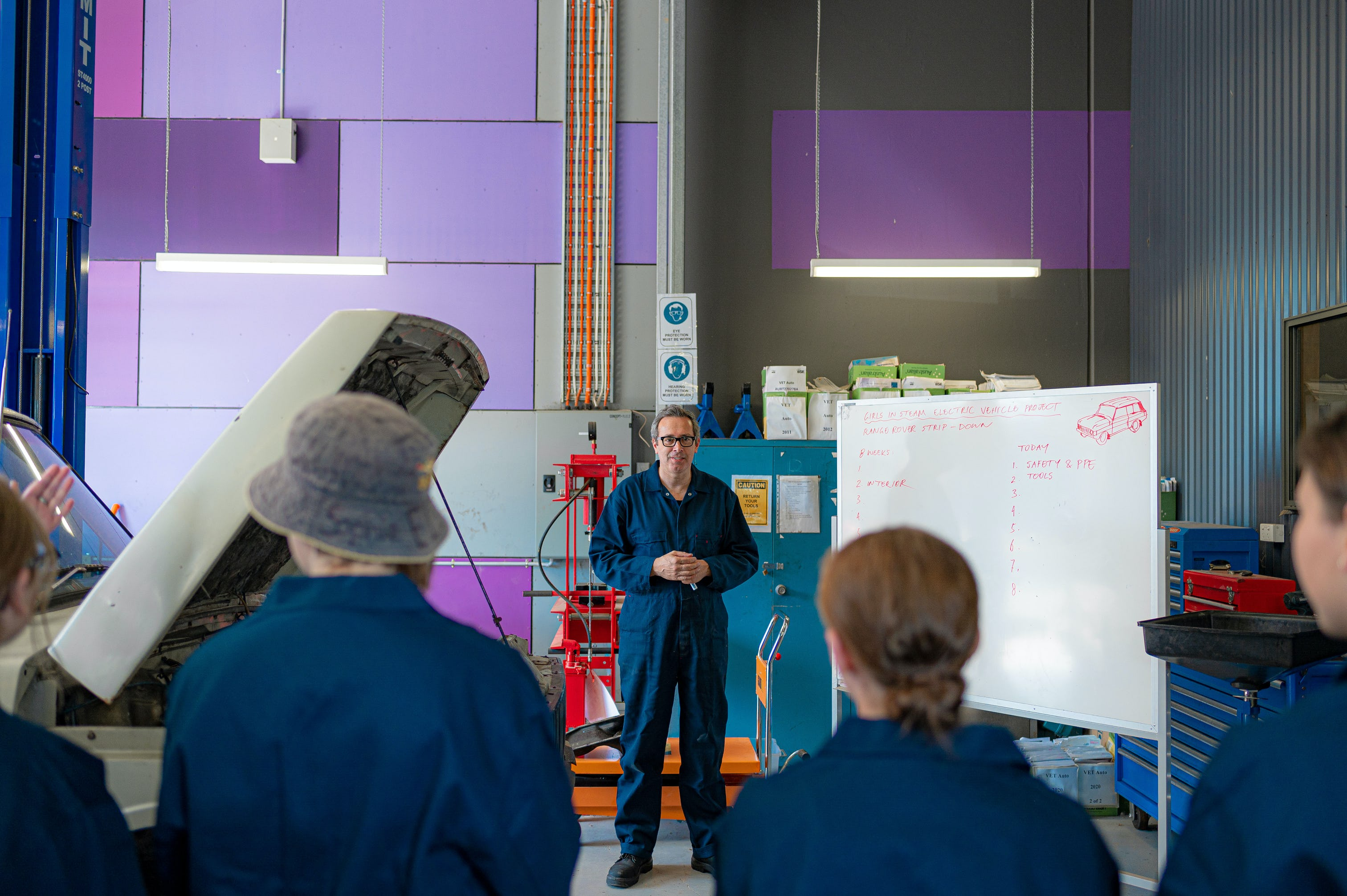 Graeme and students in the workshop at Bendigo South East Secondary College.