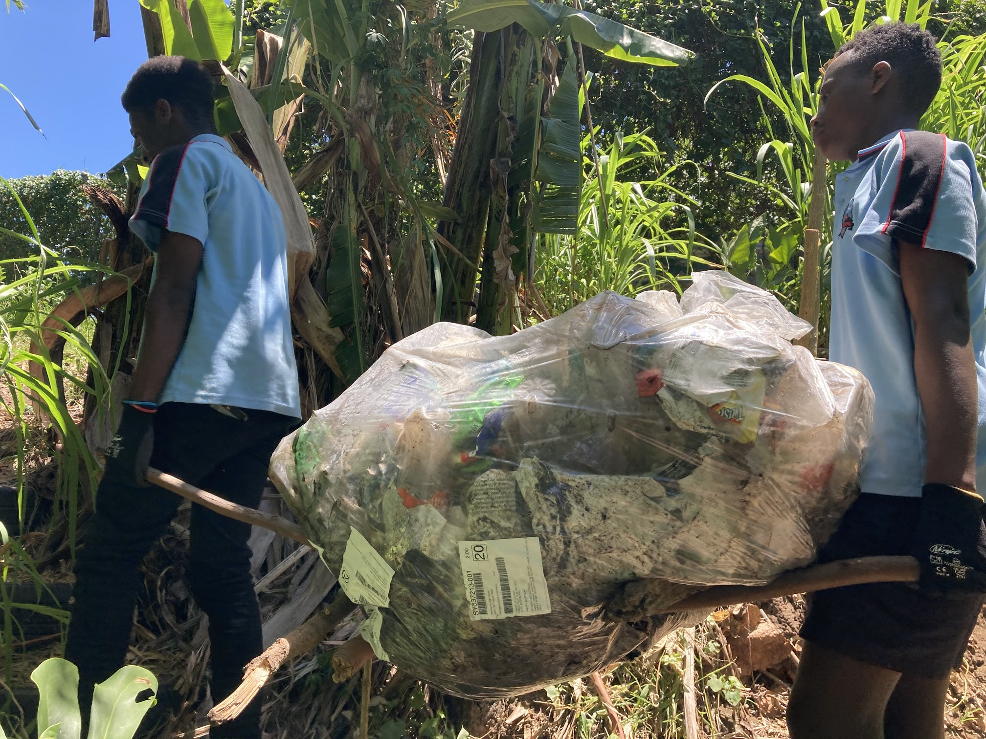 Warrawong High School students removing rubbish from the rehabilitation site